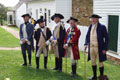 Revolutionary War soldiers meet with Colonel Monroe