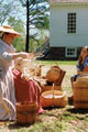 Docent demonstrates 18th-century basket weaving